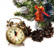 Clock, bumps on the background of a decorated Christmas tree in the white — Stock Photo