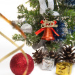 Gifts, cones, Christmas ball, serpentine, dressed up fur-tree  — Zdjęcie stockowe
