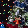 Decorated Christmas tree, the Christmas bell on a black background with bright lights — Stock Photo #33667551
