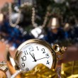 Round pocket watches lie among the gifts — Stock Photo
