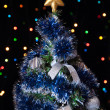 Dressed up fur-tree with the star on the top — Stockfoto