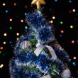 Dressed up fur-tree with the star on the top — Stock Photo