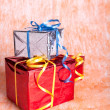 Three gift boxes on an orange background — Stock Photo