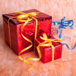 Three gift boxes on an orange background — Stock Photo #33667589