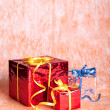 Three gift boxes on an orange background — Stock Photo #33667627