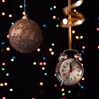 Clock,serpentine,Christmas ball on a black background with lights — Stock Photo