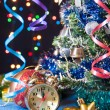 Clock,ball,the serpentine,a new year's tree on a black background with lights — Stock Photo