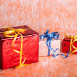 Three gift boxes on an orange background — Stock Photo #33667857