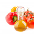 Bottle with olive oil ,tomatoes and peppers on a white background — Stock Photo