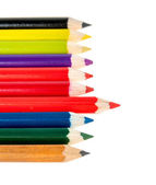 Colored pencils lie in the range of the white — Stockfoto