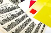 Card and dollar bills close — Stock Photo