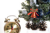 Clock,bumps on the background of a decorated Christmas tree in the white — Stock Photo