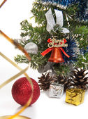Gifts, cones, Christmas ball, serpentine, dressed up fur-tree — Stock Photo