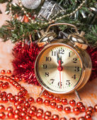 Clock, Christmas beads on the background of decorated Christmas trees — Stock Photo