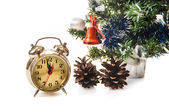 Clock,bumps on the background of a decorated Christmas tree in tree in the white — Stock Photo