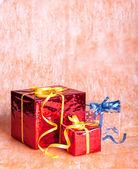 Three gift boxes on an orange background — ストック写真
