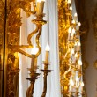 Stock Photo: Vintage candlestick lamp glowing gold plated