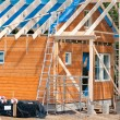 Construction of a wooden house — Stock Photo