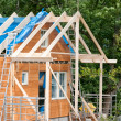 Construction of a wooden house — Stock Photo #34026117