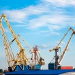 Stock Photo: Cargo cranes in the port