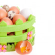 Broken chicken egg lies near a decorative basket of eggs — Stock Photo