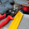 Stock Photo: Cutters and angular ruler,spool of thread are on table