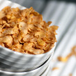 Corn flakes poured from a plate — Stock Photo