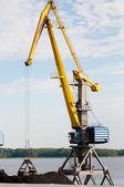 Port crane loading coal — Stock Photo
