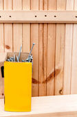 Nails in the box on the background of the boards — Stock Photo