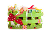 Easter eggs in the green decorative basket on the white — Stockfoto