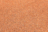 Background of red gravel — Stock Photo