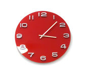Red round the clock on a white wall — Stock Photo