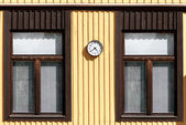 The yellow wooden wall of the two windows — Stock Photo
