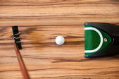 Ball to roll into the hole mini-Golf home — Stock Photo