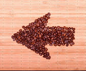Boom of coffee beans on a decorative straw — Stock Photo