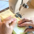 Hand of the  woman at the sewing machine — Stock Photo #43914663