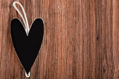 Black wooden heart with rope — Stok fotoğraf