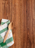Wooden spoon on towel — Stock Photo