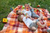 Children twins drink water — Stock Photo