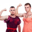 Transvestites showing biceps — Stock Photo