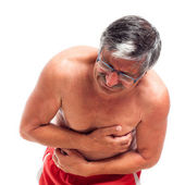 Senior man with painful stomach — Stock Photo
