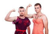 Transvestites showing biceps — Stock Photo