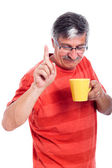 Senior man with mug — Stock Photo