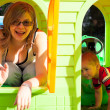 Happy womand child in playhouse — Stock Photo #13475305