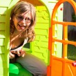 Funny womplaying in playhouse — Stock Photo #13475344
