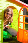 Funny woman playing in playhouse — Stock Photo