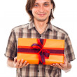 Smiling man with gift — Stock Photo