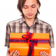 Man looking at gift — Stock Photo