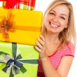 Stock Photo: Young attractive happy womwith gifts