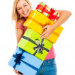 Stock Photo: Young attractive laughing womwith gifts